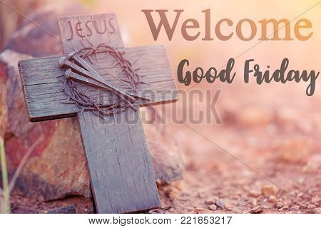 Welcome Good friday night word for Christian presentation.Easter concept.Wooden holy cross, crown of thorns and nail.