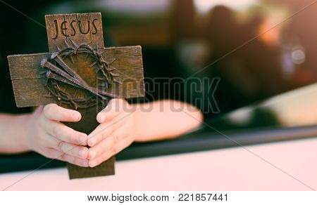 Little Girl Hands Holding A Holy Cross, Crown Of Thorns And Nail.easter And Good Friday Concept.wors