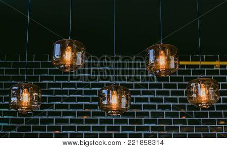 Luxury beautiful retro edison light lamp decor.Incandescent lamps in a modern cafe. Edison lamp.