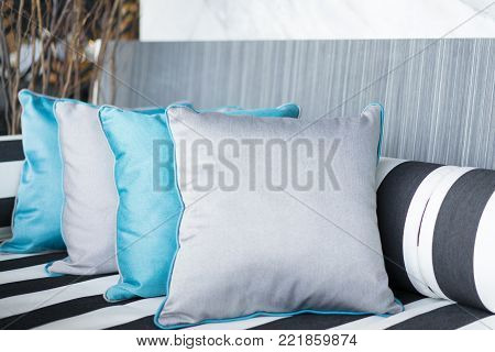 set of pillows on luxury sofa in living room, interior design.Beautiful luxury pillow on sofa decoration in living room interior for background.