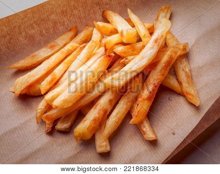 Closeup of a french fries on brown craft paper