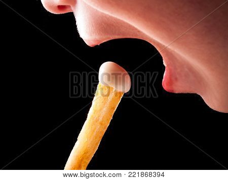 Child eating a french fries with salad cream, mayonnaise