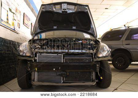 Modern Black Car In A Repair Shop