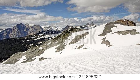 Panorama of towering peaks in the Coast Mountains of British Columbia, Canada. View of Pyroclastic Peak, Mt. Cayley and Mount Fee.