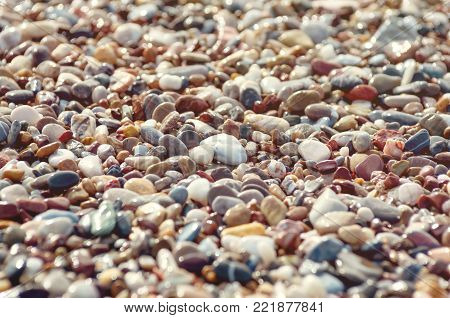 Small pebbles on the shore of the sea shore
