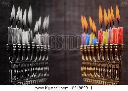 Jewish menorah with lighted candles, for Hanukkah holiday and Judaic holiday symbol