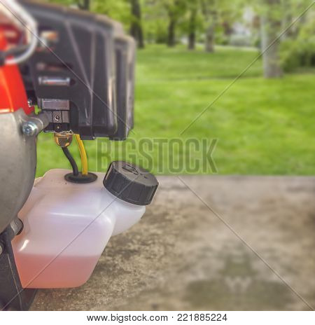 Fuel basket of lawnmower grass cutter equipment on garden terrace