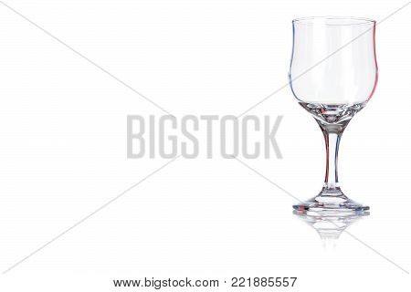 An empty white wine glass isolated on a white background. Place for your text.