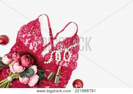 Women red lace lingerie with flowers, make up items on white background. Postcard for Womens Day. Valentines Day concept.