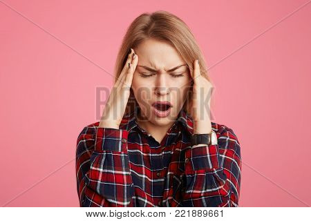Close Up Portrait Of Stressful Beautiful Female Student Has Headache After Long Exam Preparation, Cl