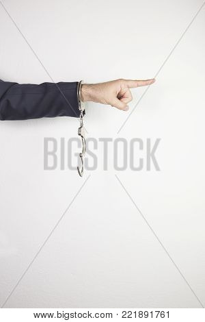 male hands in handcuffs isolated on white background. justice - concept