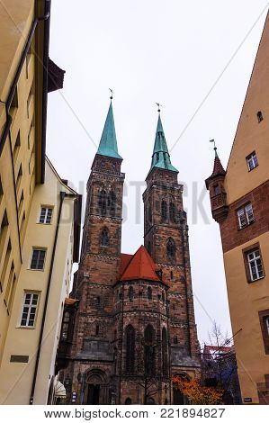 Street view on Saint Sebaldus old 13th century church in the old town of Nuremberg city Bavaria Germany travel Europe in Nurnberg