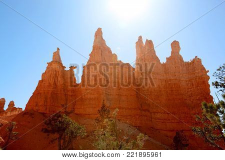 Hoodoo spires silhouetted against the bright blue sky in Bryce Canyon National Park