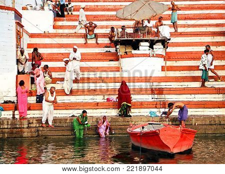 Varanasi, India - october,20,2014: boat at the river Ganges near holy ghats with people  in Varanasi, India early morning ceremony,