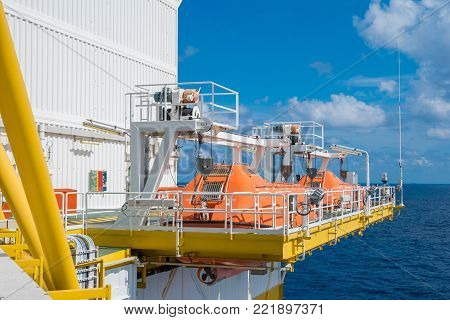 Rescue boat or life boat at oil and gas platform annual sea trial test for preventive maintenance, this use for escape or evacuate from fire when abandon platform.
