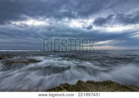 amazing long exposure of the sea waves and rocks at the coast
