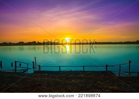 Sunset sky background. Dramatic gold sunset sky with evening sky clouds over the sea. Stunning sky clouds in the sunset. Sky landscape. Panoramic sky view