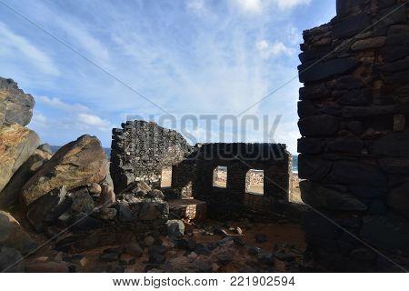 Breathtaking view of the ocean through the ruins windows