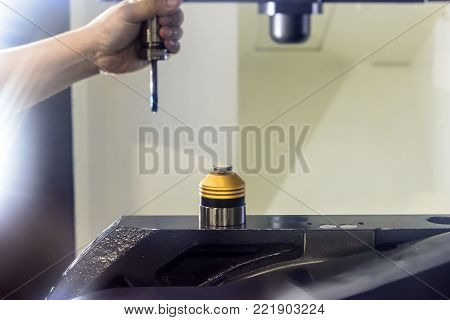 The tool length measurement at CNC machine.The tool presetter on the CNC table.