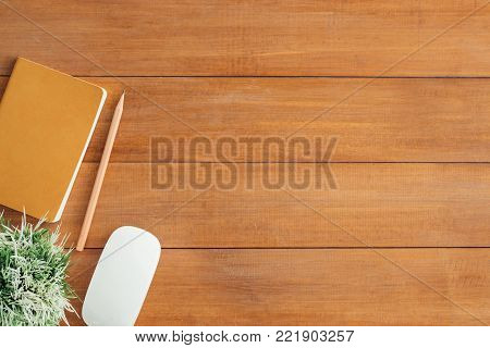 Minimal work space - Creative flat lay photo of workspace desk. Office desk wooden table background with mock up notebooks and pencil and plant. Top view with copy space, flat lay photography.