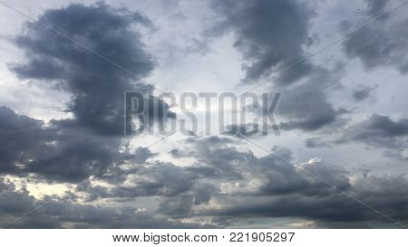 Beautiful stormy sky with clouds background. Dark sky with clouds weather nature cloud storm. Dark sky with clouds and sun