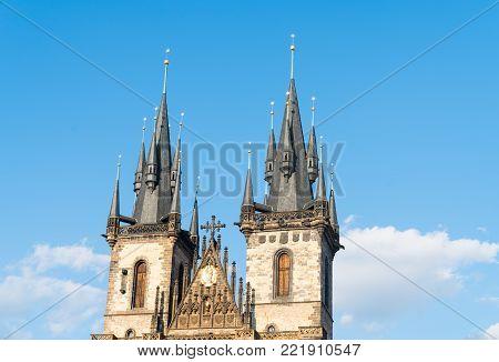 Sun illuminates gothic Spires of Church of Our Lady before Tyn, Prague, Czech Republic