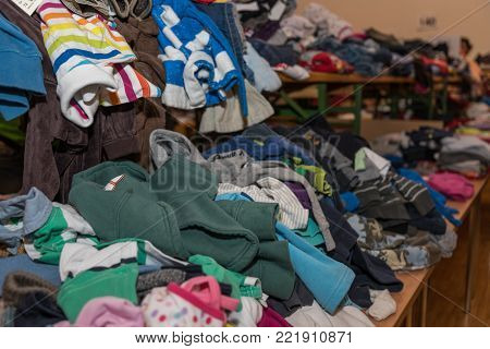 Cheap children's clothes are offered at a flea market