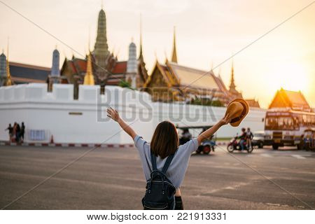 Young Woman Traveler Travelling By Bicycle Into Wat Mahathat Temple In The Sukhothai Historical Park