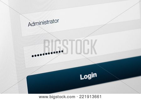 Filled login and hidden by dots password at login screen on the website
