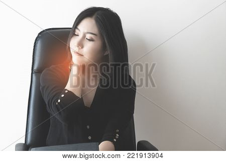 Female office worker is suffering from neck pain, office syndrome concept.