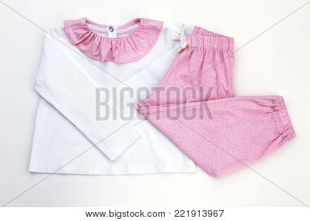 New pajama for lovely daughter. White and pink, simple fine pattern. Comfortable clothes for good night.