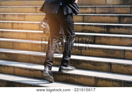 group of young handsome business man in suit walking up stairs going to work time at morning in the city, determination, confidence, corporate, lifestyle, rush hour, grow up and successful concept