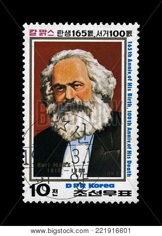 DPR KOREA (NORTH KOREA) - CIRCA 1983: canceled postal stamp printed in the DPR Korea shows Karl Marx, famous politician leader, Capital - Critique of Political Economy book author, circa 1983. Vintage stamp isolated on black background.