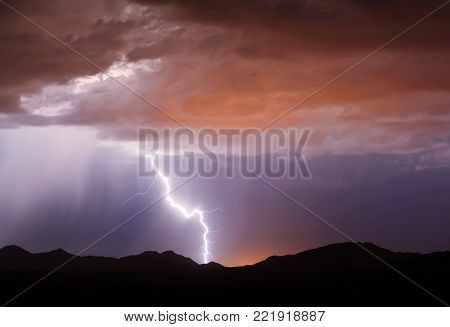 A bolt of lightning striking a mountain in an area known as the Buckeye Foothills near Arlington Arizona during the 2012 Monsoon season.