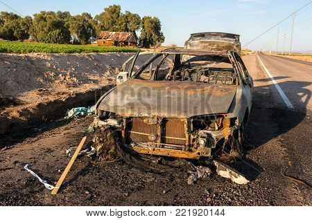 A car that I found burned out along the shoulder of Baseline Road west of State Route 85 in Arizona.
