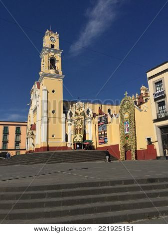 XALAPA, VERACRUZ, MEXICO- OCTOBER 27, 2017: View of Catedral Metropolitana de Xalapa decorated with floral archs in honor of Rafael Guizar y Valencia