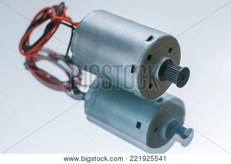 cylindrical electrical motor on white background. conversion of electrical energy into mechanical