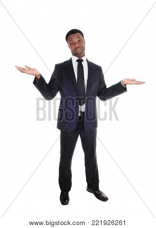 A handsome tall African American man standing in a suit with  outchteched hands is not sure, isolated for white background