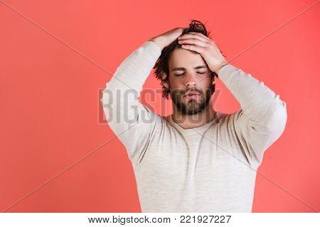 Sleepy Man With Beard On Red Background.
