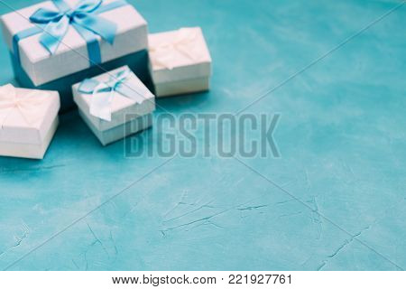 Gift selection on blue background. Copyspace concept. Holiday atmosphere. Present giving. Warm memories