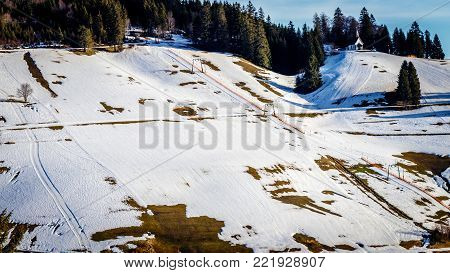 Due to the global warm up it becomes harder for the ski area's to guarantee snow. The ski slopes in the black forest often look like this where there is not enough snow to exercise the ski sport.