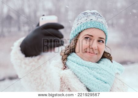 Smiling Young Woman Take Selfies In Snowing Outdoor.