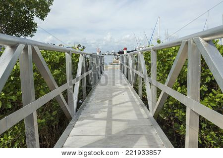 White wooden footbridge leads from the marina to the mainland, Fort Myers. Florida