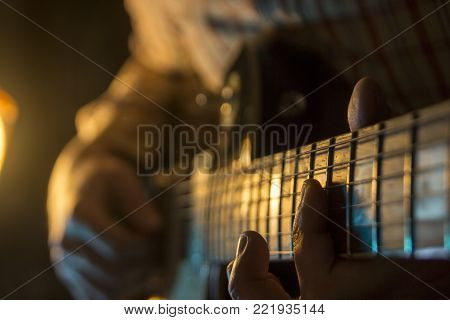 The musician is playing the guitar at a concert
