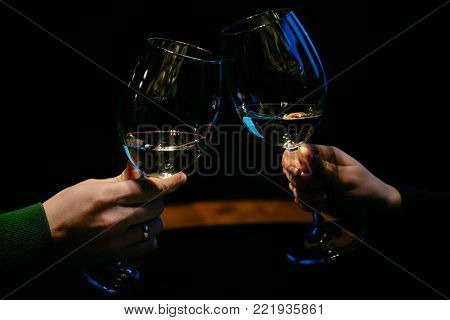Man And Woman Drinking Champagne From Glasses.