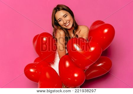 Cheerful Woman Posing At Camera With Red Balloons.