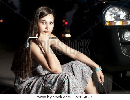 Woman By The Broken Car In The Night
