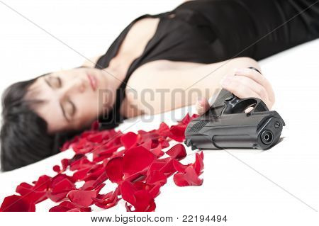 Suicide Woman Lying On The Floor With Gun And Metaphoric Blood