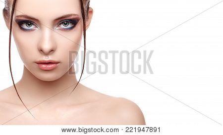 Close up half face portrait of model with glamorous makeup, wet effect on her face and body, high fashion and beauty, creative makeup theme, strobing or highlighting makeup, copy space, your text here