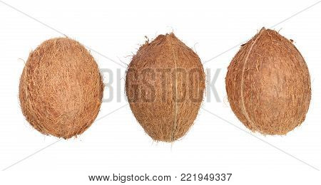 three whole coconut isolated on white background. Flat lay. Top view.